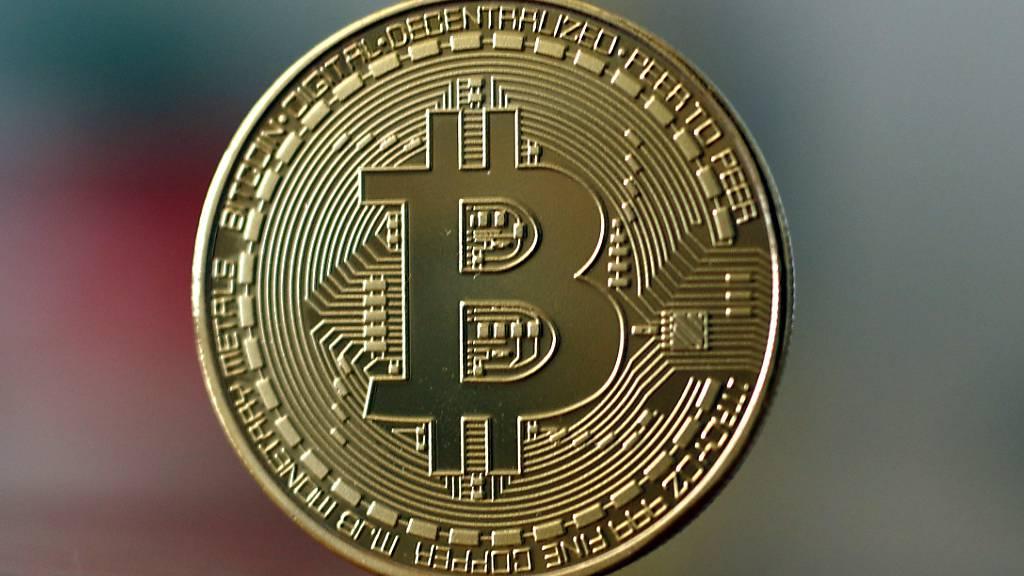Der Höhenflug des Bitcoin beflügelt auch die Ambitionen von Krypto-Plattformen, wie Coinbase, an die Börse zu gehen. (Archivbild)