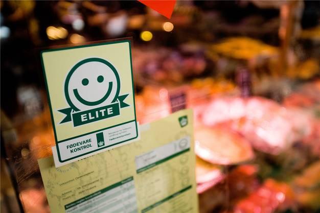 In Dänemark erfahren die Konsumenten dank Smileys, wie es um die Hygiene von Restaurants steht.KHAN TARIQ MIKKEL/Keystone