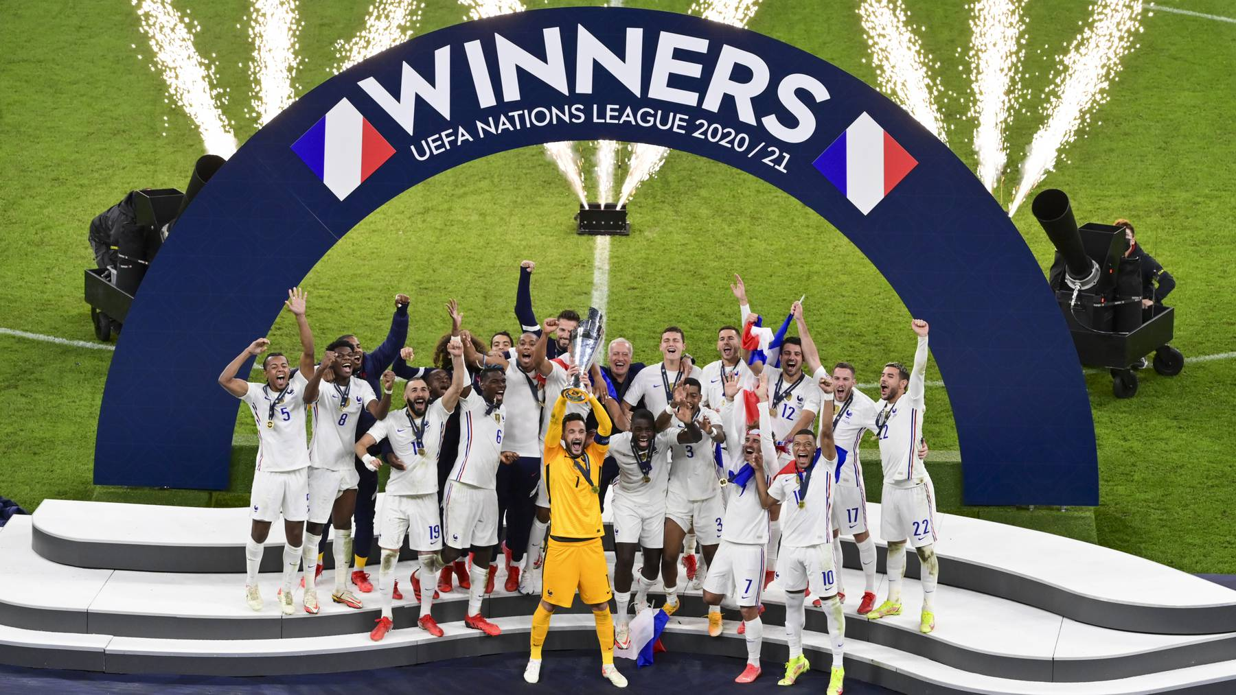 French players react with their trophy after defeating Spain to win the UEFA Nations League final soccer match at the San Siro stadium, in Milan, Italy, Sunday, Oct. 10, 2021.
