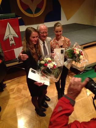 Auf dem Bild sieht man die drei glücklichen Sieger