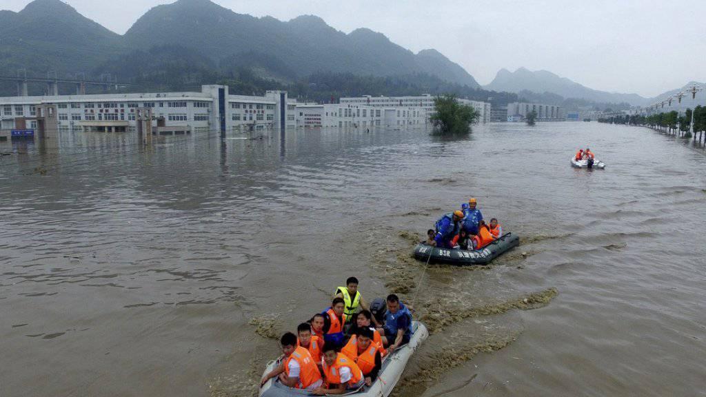 Überschwemmung im chinesischen Zijin im Juni 2016: Naturkatastrophen sind die Hauptursache, wieso Menschen ihr Zuhause verlieren. In China gelten 7,4 Millionen Menschen als Vertriebene.