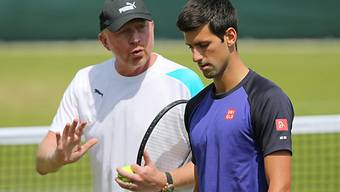 Boris Becker (l.) bleibt Coach von Novak Djokovic