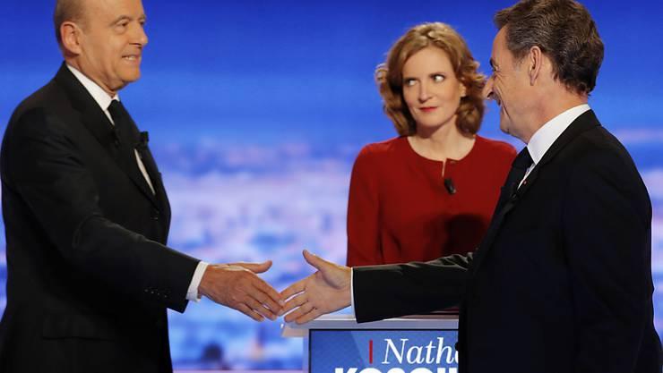 Im Siebnerfeld der französischen Konservativen haben zwei Männer die besten Chancen auf eine Nomination als Präsidentschaftskandidat: Ex-Premier Alain Juppé (links) und Ex-Präsident Nicolas Sarkozy.