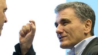 Der griechische Finanzminister Euclid Tsakalotos zeigt sich mit den Bedingungen der Finanzminister der Eurozone für das Ende des Rettungsprogramms für Griechenland zufrieden. . (Foto:Virginia Mayo/AP)