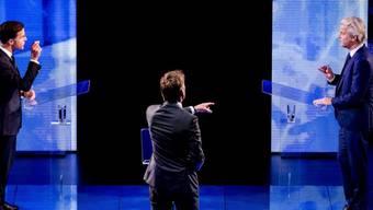 Mark Rutte (l) und Geert Wilders am Montagabend bei ihrem TV-Duell.