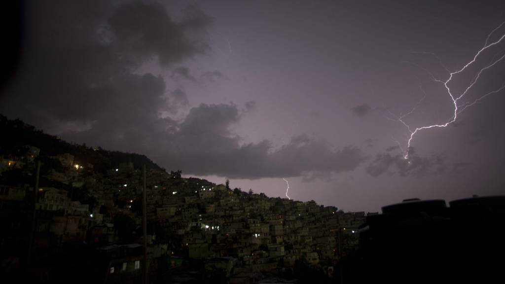 A photograph taken on 30 July 2010 shows a storm and lightning in the area of Philipeau and Petion Ville in Port au Prince, Haiti.