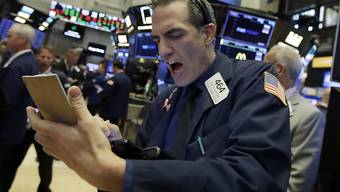 Hektik an den Börsen weltweit. Die Festnahme der Finanzchefin des chinesischen Netzwerkausrüsters Huawei auf Anordnung von US-Behörden lässt die Aktienkurse einbrechen.(Archivbild)