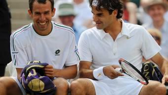 Roger Federer und Dominik Hrbaty beim Wimbledon-Turnier 2008.
