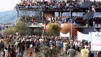 Die Besetzung von «Kaiseraugst» im Sommer 1975. Aus der ganzen Schweiz strömten die Besetzer auf das Gelände, an einzelnen Tagen zählte man bis zu 15000 Demonstranten. Keystone/Zimmermann