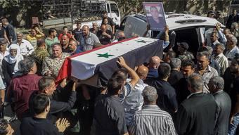 Trauer in Suweida: Einer von über 200 Särgen nach dem IS-Massaker.
