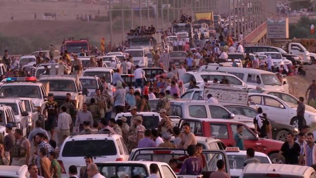 Irakische Jesiden flüchten vor den IS-Kämpfern in die Stadt Erbil
