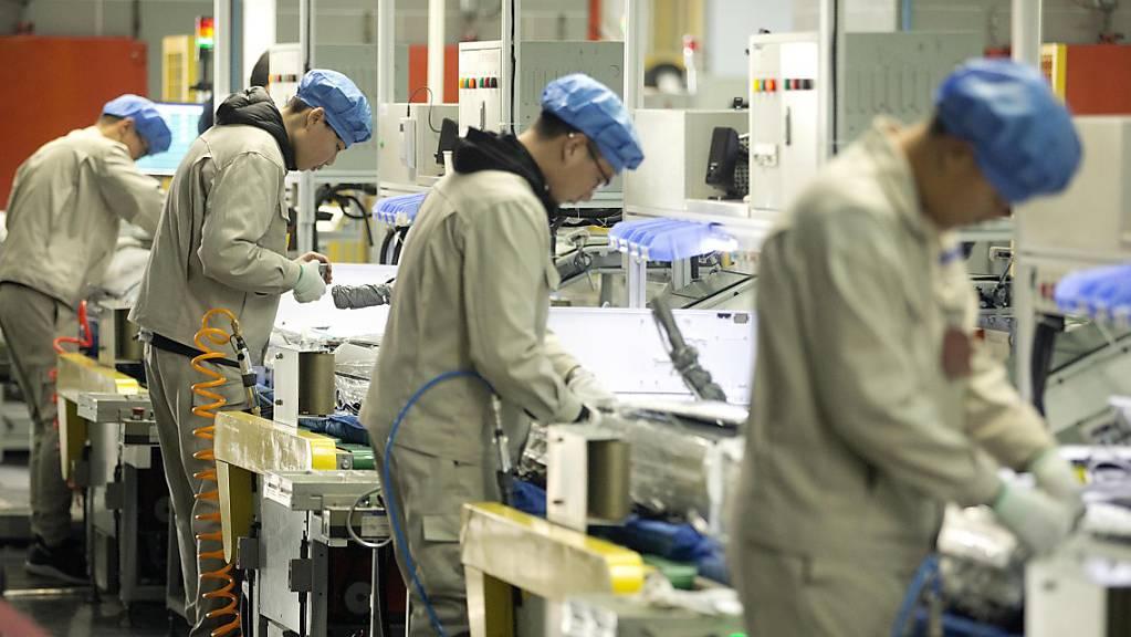 Rückläufige Exporte: Der Handelsstreit zwischen den USA und China belastet die Industrie der chinesischen Volksrepublik immer mehr. (Archivbild)