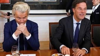Am Morgen danach: Verlierer Geert Wilders und Premier Mark Rutte gestern beim gemeinsamen Frühstück. Y. Herman/Reuters