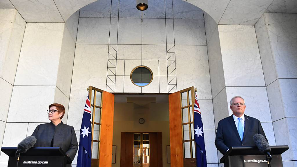 Minister for Foreign Affairs Marise Payne and Prime Minister Scott Morrison address the media at a press conference at Parliament House in Canberra, Monday, March 29, 2021. (AAP Image/Mick Tsikas) NO ARCHIVING