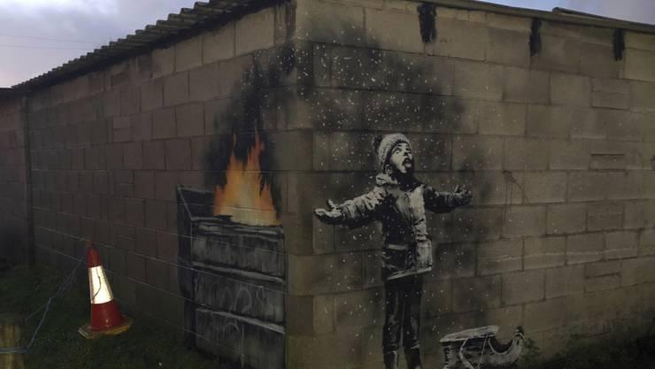 Das Banksy-Werk in Port Talbot, Wales, wurde für einen sechsstelligen Betrag verkauft. Der Käufer will es vorerst am Entstehungsort lassen und damit den Tourismus ankurbeln.
