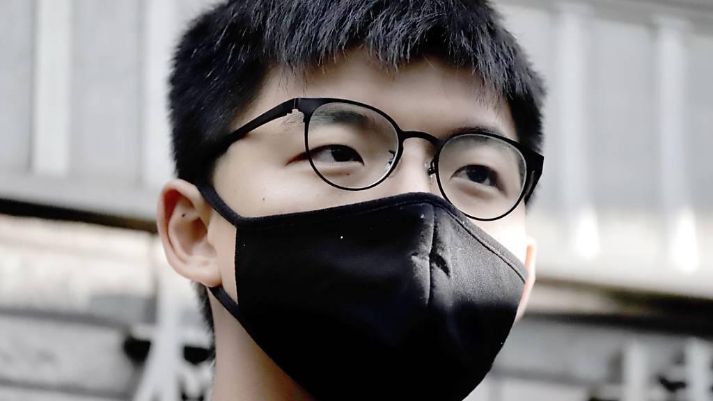 ARCHIV - Der pro-demokratische Aktivist Joshua Wong trifft zu einer Anhörung am West Kowloon Magistrates' Courts ein. Foto: Liau Chung-Ren/ZUMA Wire/dpa