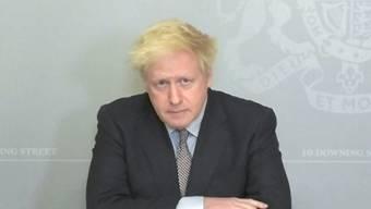 SCREENSHOT - Boris Johnson, Premierminister von Großbritannien, spricht in einer Videokonferenz in der 10 Downing Street. Foto: House Of Commons/PA Wire/dpa - ACHTUNG: Nur zur redaktionellen Verwendung im Zusammenhang mit der aktuellen Berichterstattung und nur mit vollständiger Nennung des vorstehenden Credits