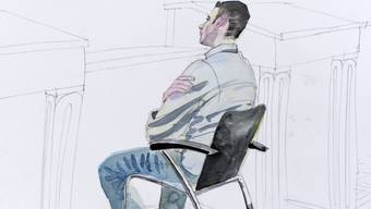 Der Hauptangeklagte sitzt im Gerichtssaal in Zürich