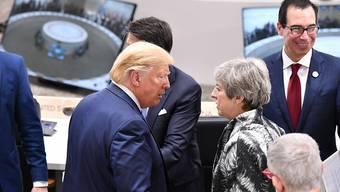 US-Präsident Donald Trump und die britische Premierministerin Theresa May am G20-Gipfel im japanischen Osaka. (Archivbild)