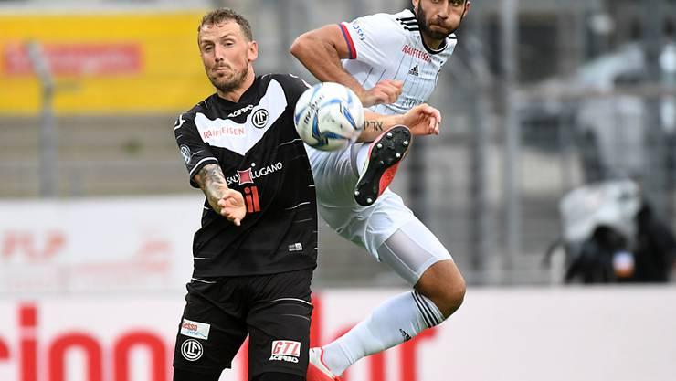 Luganos Einwechselspieler und Torschütze Alexander Gerndt (links) gegen Basels Eray Cömert