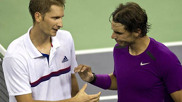 Florian Mayer (links) zwang Rafael Nadal in die Knie