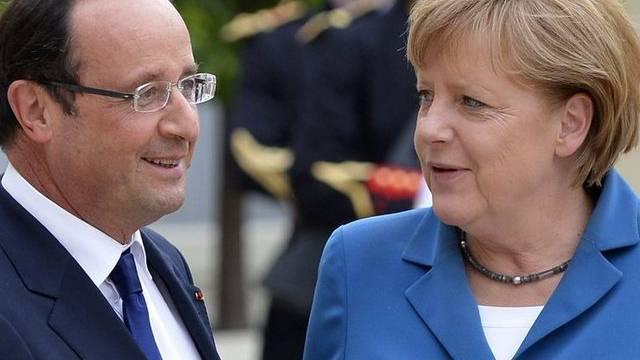 Frankreichs Präsident Francois Holland mit der deutschen Bundeskanzlerin Angela Merkel (Archiv)