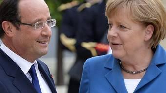 Wollen die EU-Integration weiterverfolgen: Frankreichs Präsident Francois Holland mit der deutschen Bundeskanzlerin Angela Merkel