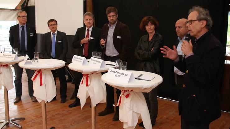 Am Podium von links Ernst Zingg, Bernard Staub, Markus Graf, Paul Knüsel, Regula Buchmüller, Bernhard Ruhstaller und Kees Christiaanse.