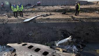 Nach dem Absturz eines ukrainischen Passagierflugzeugs im Iran liegen die Trümmerteile weit verstreut an der Absturzstelle.