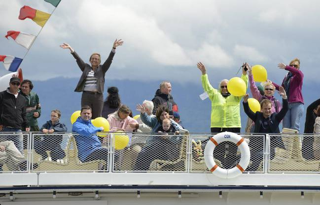 Winkende Passagiere