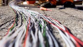 Glasfaser-Leitungen der Swisscom. (Archiv)