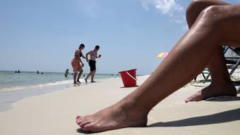 Ferien am Strand: Das Internet scheint bei der Planung vertrauenswürdiger als der Katalog.