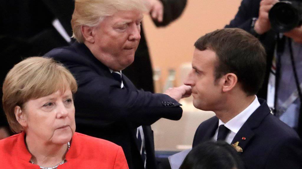 US-Präsident Donald Trump und Frankreichs Präsident Emannuel Macron am G20-Gipfel in Hamburg im Juli 2017. (Archivbild)