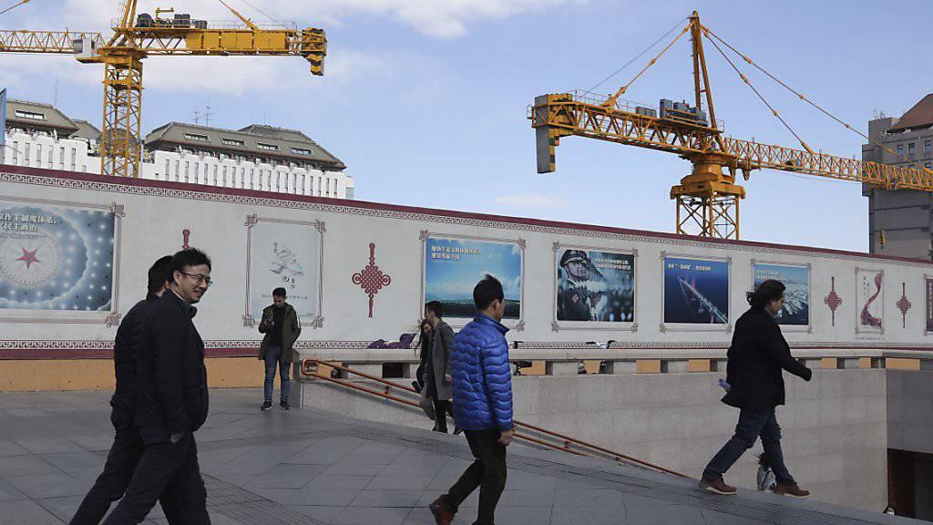 China investiert viel in die Infrastruktur. Dennoch dürfte sich das Wachstum laut OECD langfristig verlangsamen (Themenbild).