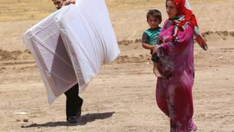 Vor den Kämpfen in Tal Afar geflüchtete irakische Familie