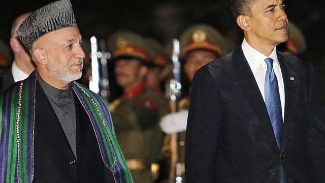 Karsai (l.) und Obama