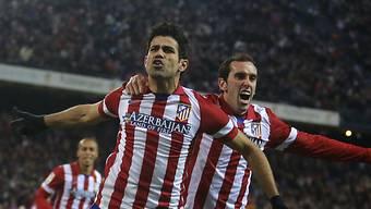 Atleticos Doppeltorschütze Diego Costa (l.) lässt sich feiern.