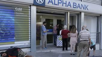 Ab Montag wieder offen: Banken in Griechenland dürfen wieder Geld herausgeben