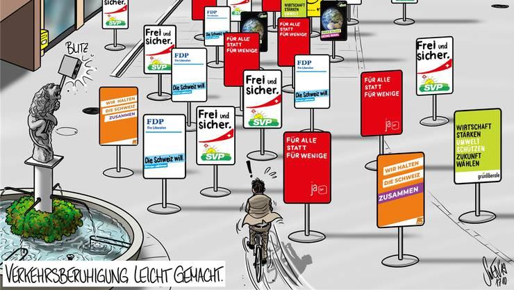 Unser Karikaturist wüsste, wie sich der Wahlkampf und der Wunsch nach langsameren Velos in der Weiten Gasse in Baden kombinieren liessen.