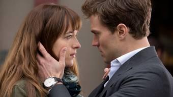 Dakota Johnson und Jamie Dornan in Fifty Shades of Grey.