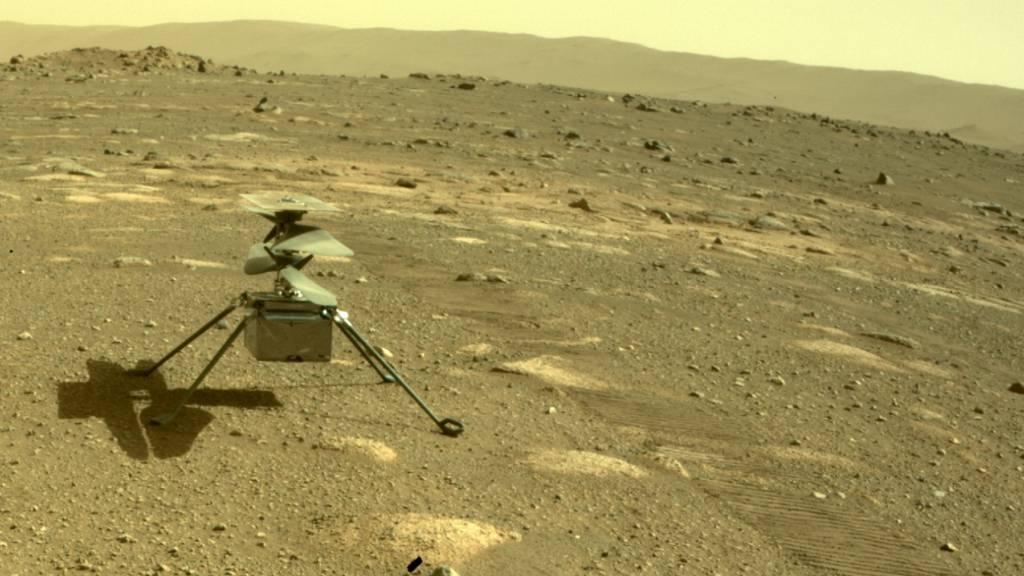 ARCHIV - Der Hubschrauber «Ingenuity» der US-Raumfahrtbehörde Nasa auf dem Mars. Foto: NASA/JPL-Caltech/dpa - ACHTUNG: Nur zur redaktionellen Verwendung im Zusammenhang mit der aktuellen Berichterstattung und nur mit vollständiger Nennung des vorstehenden Credits