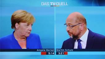 Angela Merkel beim TV-Duell gegen Herausforderer Martin Schulz: Eine klare Niederlage hat die Kanzlerin abwenden können. Key