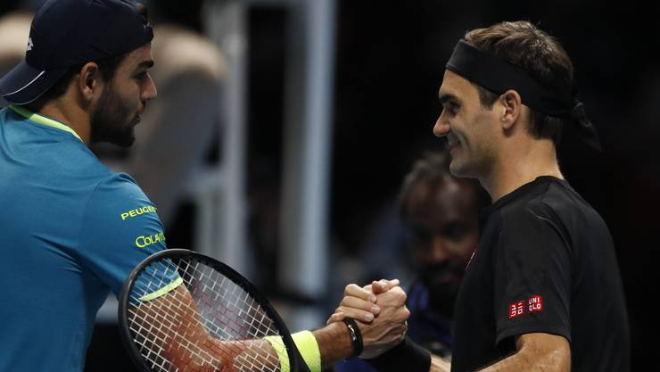Switzerland's Roger Federer, right, shakes hands with Italy's Matteo Berrettini after defeating him in their their ATP World Tour Finals singles tennis match at the O2 Arena in London, Tuesday, Nov. 12, 2019. (AP Photo/Alastair Grant)