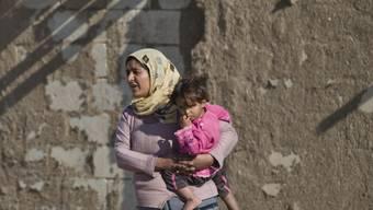 Kurdische Frau mit Kind (Symbolbild)