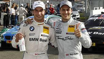 Bruno Spengler (links) gewann den DTM-Krimi gegen Gary Paffett