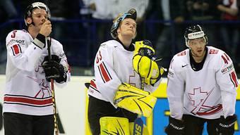 Schlecht belohnt: Vauclair, Goalie Genoni und Bieber (v.l.)