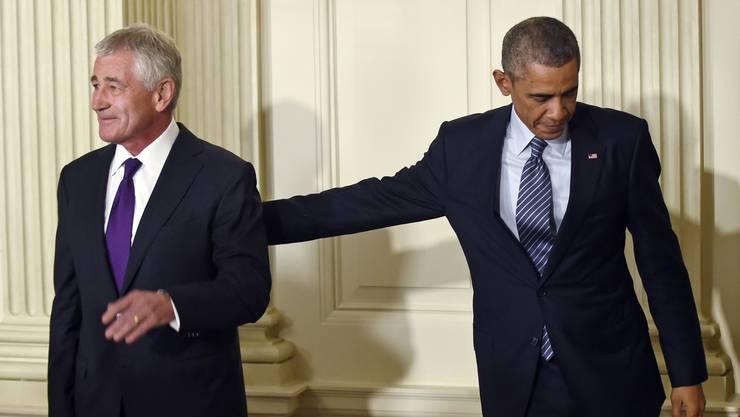 Abgeschoben: Präsident Obama trennt sich von Verteidigungsminister Hagel.