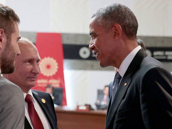 Doch noch ein Lächeln zum Schluss: Russlands Präsident Putin gibt Obama am APEC-Gipfel in Lima eine Willkommensgarantie für die Zukunft.