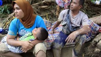 Flucht vor Überflutungen in Aceh (Archiv)