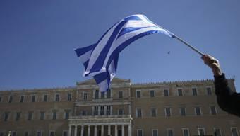 Die griechischen Politiker können nach dem erfolgreichen Schuldenschnitt aufatmen (Archiv)